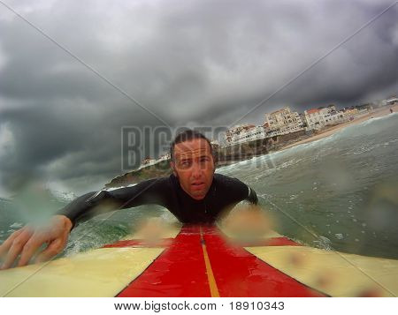 Surfer Paddling Out