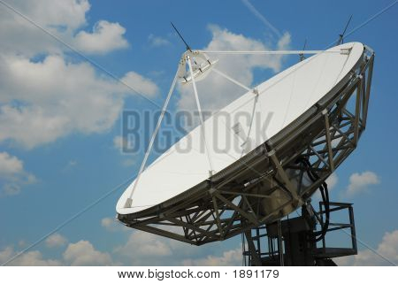 Satellite Dish With Blue Cloudy Sky