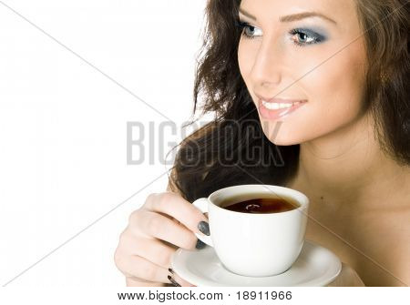 Beautiful young woman drinking a cup of hot tea or coffee