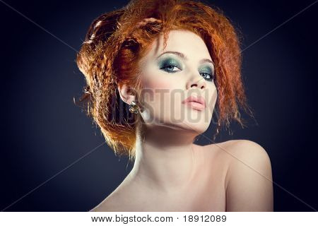 Beautiful redhead woman. Perfect classy hair style and makeup.