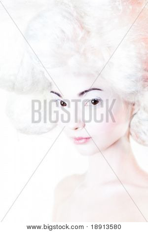 portrait of a young woman with big spheres of white hair and pink make up. stylized like marshmallow