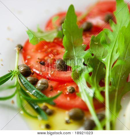 Tomato salad with arugula and caper dressing