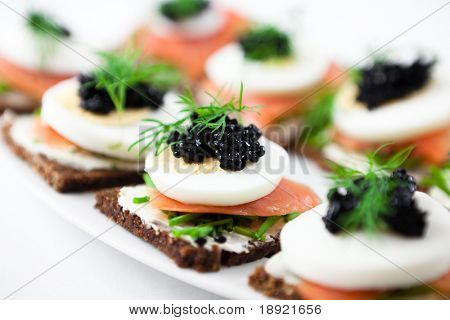 Canapes with smoked salmon and caviar