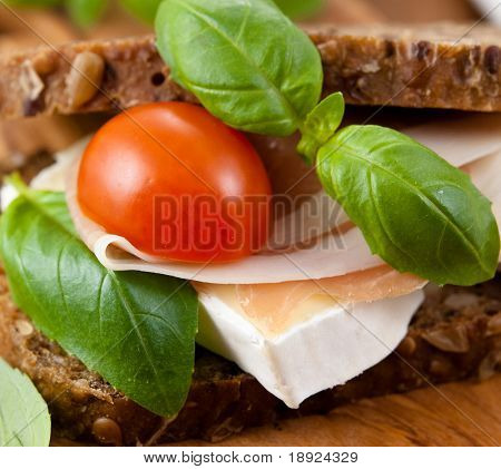 Sandwich with prosciutto crudo and brie