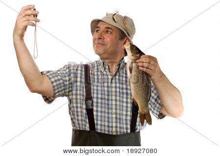 Senior fisherman with his catch (isolated on white)