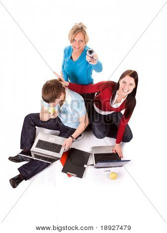 Group of happy students with the laptops and web cam (isolated on white)