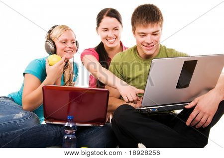 Group of students having fun, doing home work (isolated on white)