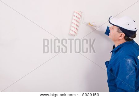 Man painting the wall
