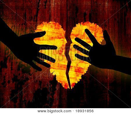 Broken heart & hands on grunge background