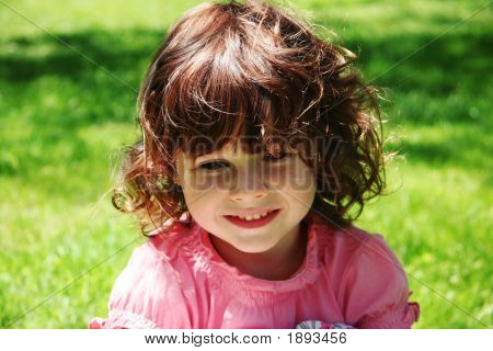 Little Girl In Looking Down Outdoors