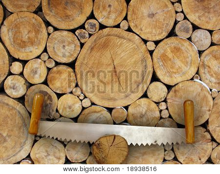 two-handled saw on wooden background