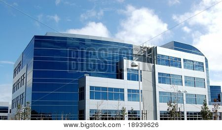 modern office building with reflections from sky