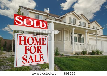 Sold Home For Sale Sign & Home