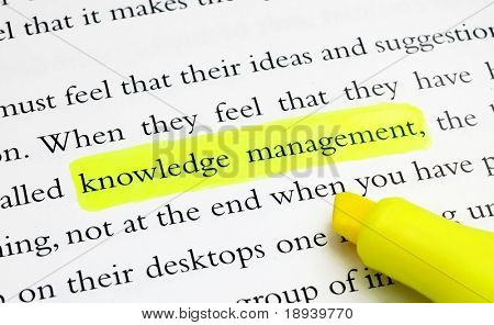 The word knowledge management highlighted with a yellow marker