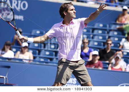 TORONTO- AUGUST 12:Roger Federer plays against Michael Llodra  in the Rogers Cup 2010 on August 12, 2010 in Toronto, Canada.