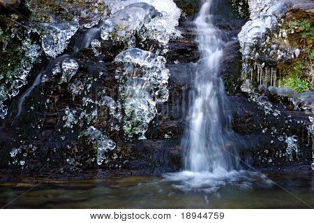 Detail of a small waterfall in a mountain torrent, west Alps.