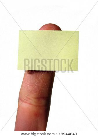 Finger holding a empty yellow notecard; isolated on white background