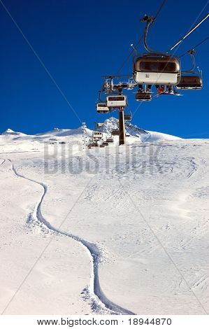 Chair-lift and ski slope; high mountain, winter ski area, Zermatt; Swiss.