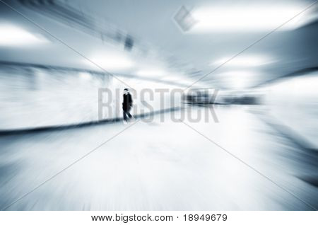 A person lost in the rush of city life.