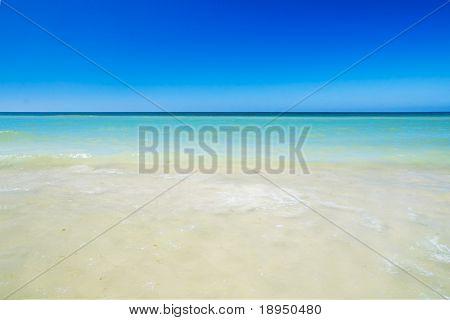 Tropical beach, sunny blue sky