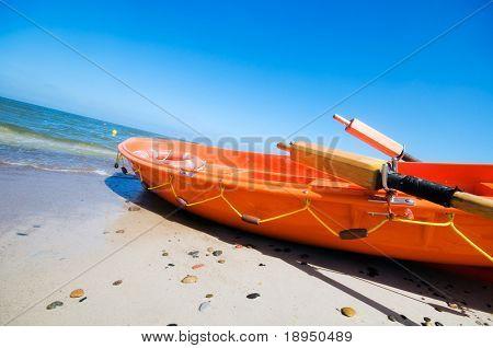 Orange rescue boat by the sea