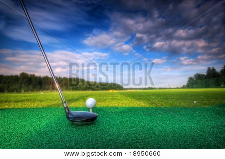 Playing golf. Golf club and ball. Preparing to shot