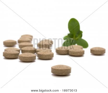 herbal pills isolated on white background