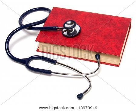 stethoscope on red book isolated on white background