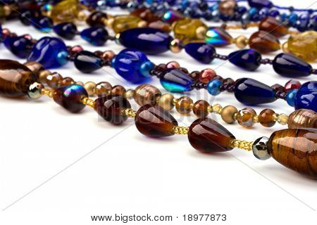 colourful beads background on white