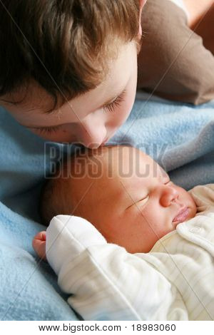 dreaming newborn baby and 5 years old brother