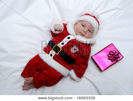 Newborn baby dressed in santa claus costume