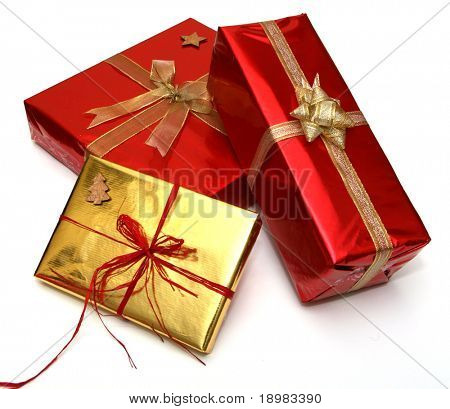 Gift boxes with golden and red ribbons isolated on white background