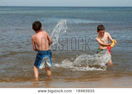 Happy summer child. Two kids playing together on the beach