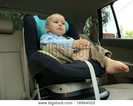 18 months old baby boy in car safety seat.