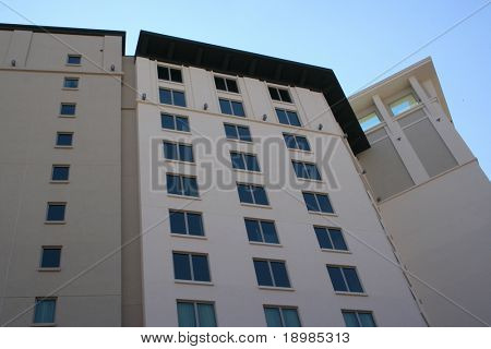 A tall building view from below.  Taken on a nice bright day.  Image has a lot of detail.