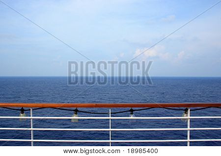 An ocean view from the side of a cruise ship.
