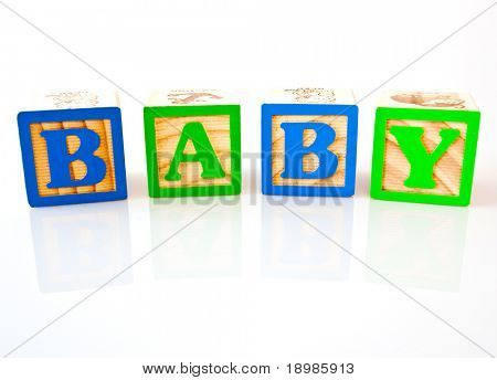 The letters B, A, B, Y spelling baby with wooden blocks