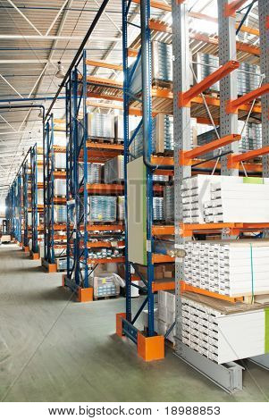 rack stack arrangement of wood furniture in a production store warehouse