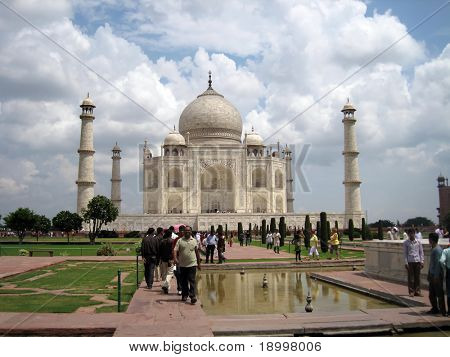 AGRA, INDIA - AUGUST 15: People visiting the most known religious site in India and most beautiful wonders of the world - Taj Mahal mosque. August 15, 2010 in Agra, India.