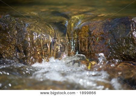 Little Rill With Brown Stones And Rocks