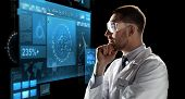 technology, science, and people concept - male doctor or scientist in white coat and safety glasses  poster