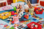 Kindergarten tables with painting brush and teacher in interior . Preschool class waiting kids. Play poster