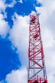 Mobile Phone Communication Antenna Tower With Satellite Dish On Blue Sky Background With Sun Ray Fla poster