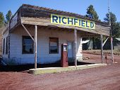 picture of yesteryear  - A decaying, but still standing, abandoned gas station along old Route 66 outside Flagstaff, AZ