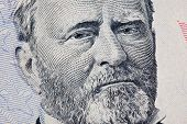 A US Fifty 50 Dollar Bill close up of Grant on a white background