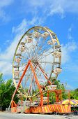stock photo of ferris-wheel  - An amusement park ferris wheel with vivid colors - JPG