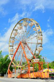 pic of ferris-wheel  - An amusement park ferris wheel with vivid colors - JPG
