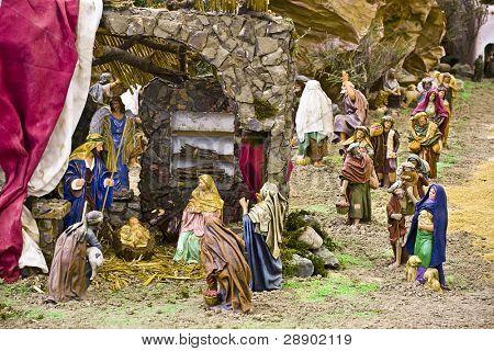 Jesus Christ, Virgin Mary and Joseph in a crib scene
