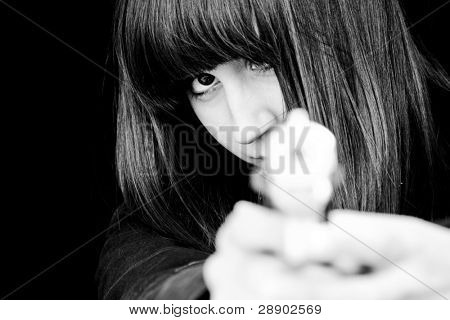 Mad woman aiming at you with a gun.