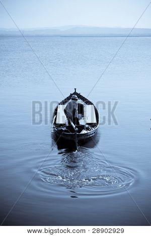 Fisherman going to work in a beautiful selenium tone.